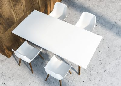 Top View Of White Dining Table With Four Chairs Standing In Dini